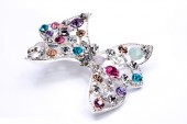 Brooch with a bow of Gems isolated on white — Stock Photo