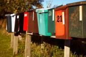 Mailboxes on line in varying condition. — Stock Photo