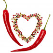 Red hot pepper in pods and colorful mixture of peppercorns. Concept of love. — Stock Photo #57402681