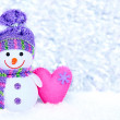 New Year 2015. Funny snowman with pink handmade hearts on snow. Silver background. — Stock Photo #57850969