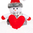 New Year 2015. Snowman with handmade red heart on snow. — Stock Photo #57931365
