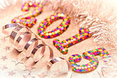 New Year 2015 decoration, colorful digits, silver tinsel, serpentine, stars — Stock Photo