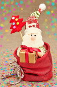 New Year 2015 decoration. Cute Santa Claus in sack of presents — Stock Photo