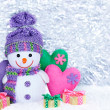 New Year 2015. Snowman with handmade hearts and gift boxes — Stock Photo #59148407