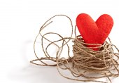 Valentine's Day. Red handmade heart in nest  of twine — Stock Photo
