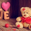 Valentines Day. Teddy Bear Loving. Hearts, Handmade word Love. Retro. — Stock Photo #61106349