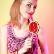Portrait of mischievous redhead girl with big lollipop. Fashion dressed — Stock Photo #75946117