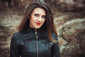 Sexy young woman in leather jacket — Stock Photo