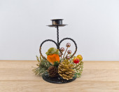 Heart-shaped  iron support  for pillar candle against white background — Stock Photo