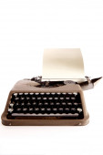 Typewriter letter and bow ribbon cover is open — Stock Photo