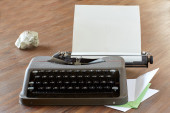 Typewriter on a table with letterhead paper — Stock Photo