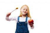 Girl enchant a apple — Stock Photo