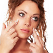 Woman is wearing a face cream — Stock Photo #69242891