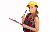 Young woman with hard hat and writing board — Stockfoto