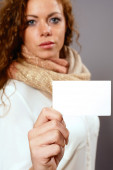 Woman with white advertising sign — Stockfoto