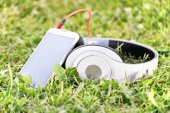 Headphones and smart phone on a meadow — Stock Photo