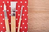 Paint brush on a wooden background — Stock Photo