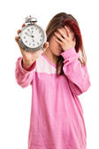 Young girl in pyjamas overslept — Stock Photo