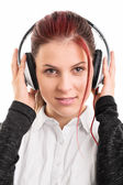 Portrait of a young girl with headphones on — Stock Photo