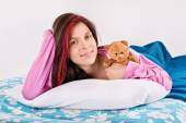 Young girl waking with her teddy bear — Stock Photo