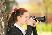 Young girl shooting her camera — Stock Photo