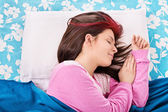 Young girl sleeping in her bed — Stock Photo