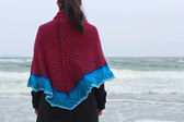 Girl in a shawl on a sea bank — Stock Photo