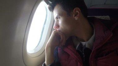 Bored airplane passenger — Stock Video
