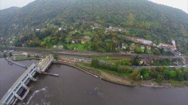 River dam and small village — Stock Video