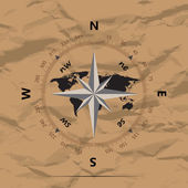 Compass with earth on a background of crumpled paper vector illustration — 图库矢量图片