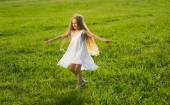 Little girl running along the meadow. — Stock Photo