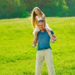 Little girl with father. — Stock Photo #74847077