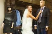 The attractive bride in showcase. — Stock Photo