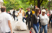Newlyweds are walking on the street and smilling. — Stock Photo