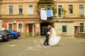 The groom and his bride in courtyard. — Stock Photo