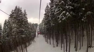 Sitting down on the ski lift in Bukovel, Ukraine — Stock Video