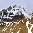 The end of a glacier where it falls into the Arctic Ocean in Spitsbergen, Svalbard, Norway. — Stock Photo #72425945