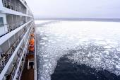 Cruise Ship bow passing icy snow arctic waters near Spitsbergen, Svalbard, Norway. — Stock Photo