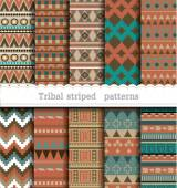 Tribal striped seamless patterns — Stock Vector