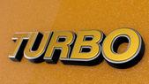 TURBO sign, label, badge, emblem or design element on car print. — Stock Photo