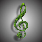 Musical note clef symbol made from green leaves isolated on white background. 3d render — Zdjęcie stockowe