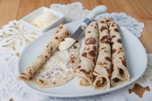 Lefse rolled on a plate — Stock Photo