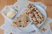 Rolled lefse served on a plate — Stock Photo