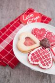 Plate of valentine cookies on rustic table — Stock Photo