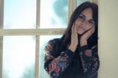 Thoughtful beautiful woman in the window — Foto Stock