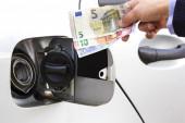 Money and fuel — Stock Photo