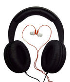 Two pairs of headphones. Black and red headphones — Stock Photo