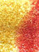 Onscherpe achtergrond van gouden en rood glitter sparkle — Stockfoto