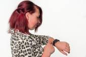 Young Woman looks at her new digital watch — Foto de Stock