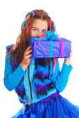 Surprised girl with a gift on an isolated background — Stock Photo